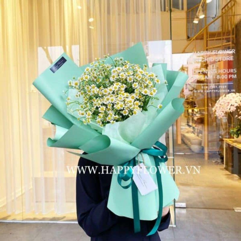 bó hoa cúc tana gói giấy xanh