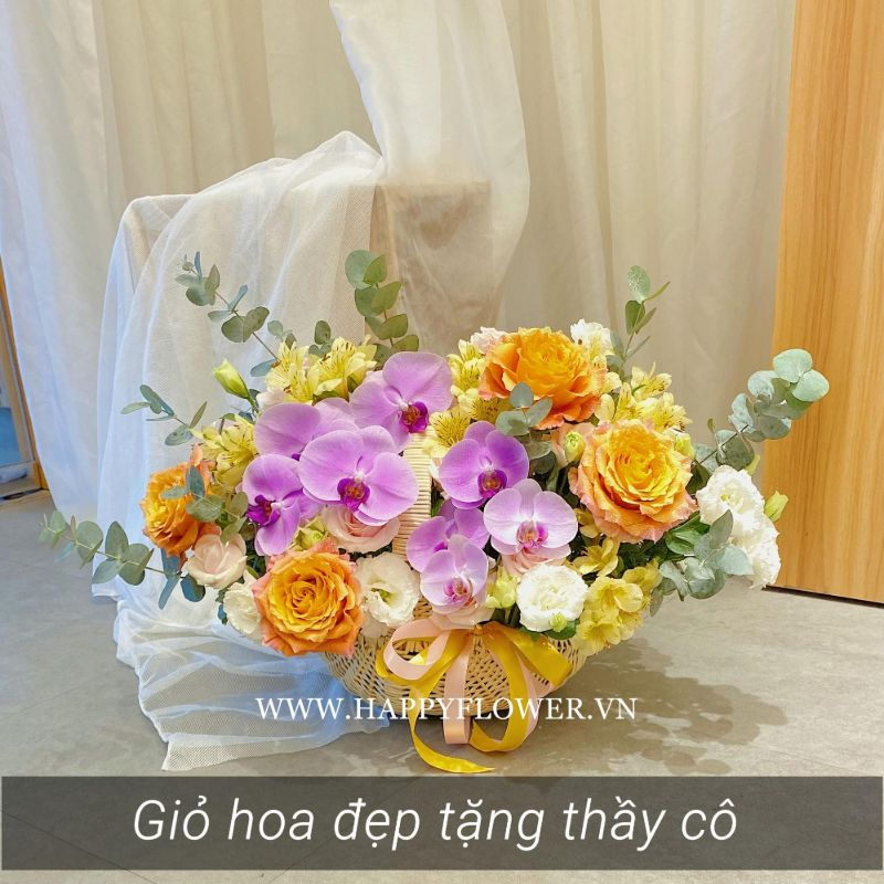 Giỏ hoa mang tên Spirit mix hoa lan tím và hồng cam
