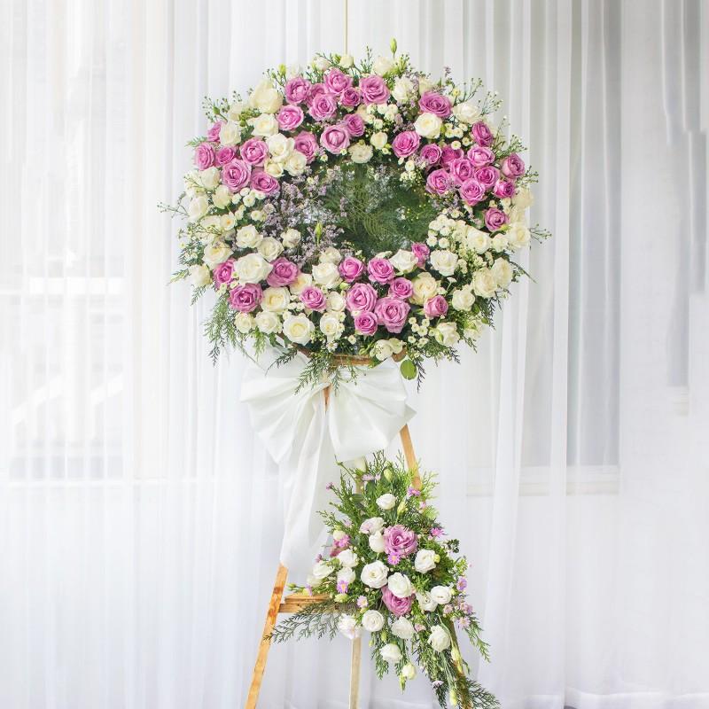 vòng hoa đám tang hình tròn tông hồng