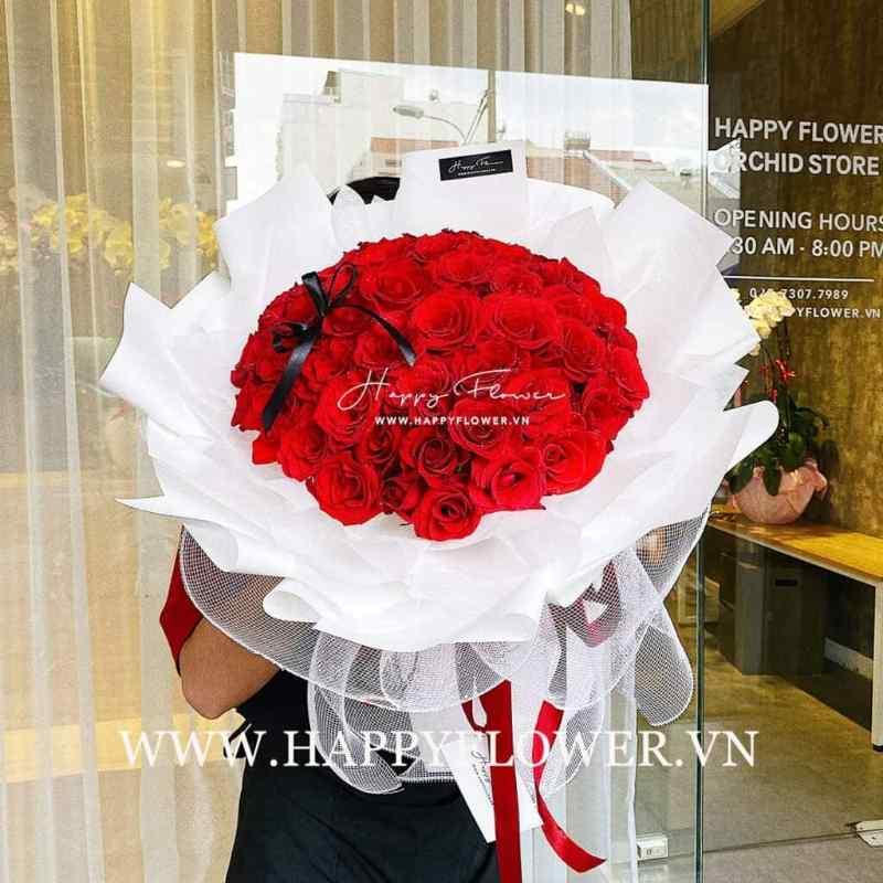 bó hoa hồng đỏ tròn giấy trắng