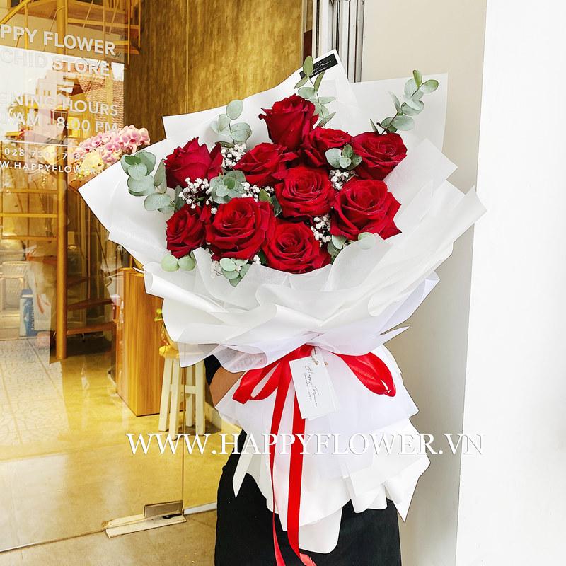 bó hoa sinh nhật khổng lồ hoa hồng đỏ rực gói cùng giấy trắng