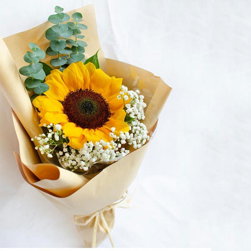 bó hoa hướng dương 1 bông màu vàng trong giấy gói