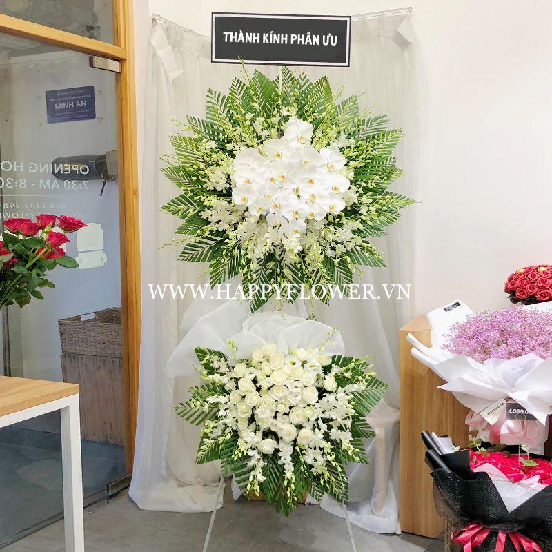 vòng hoa chia buồn lan trắng
