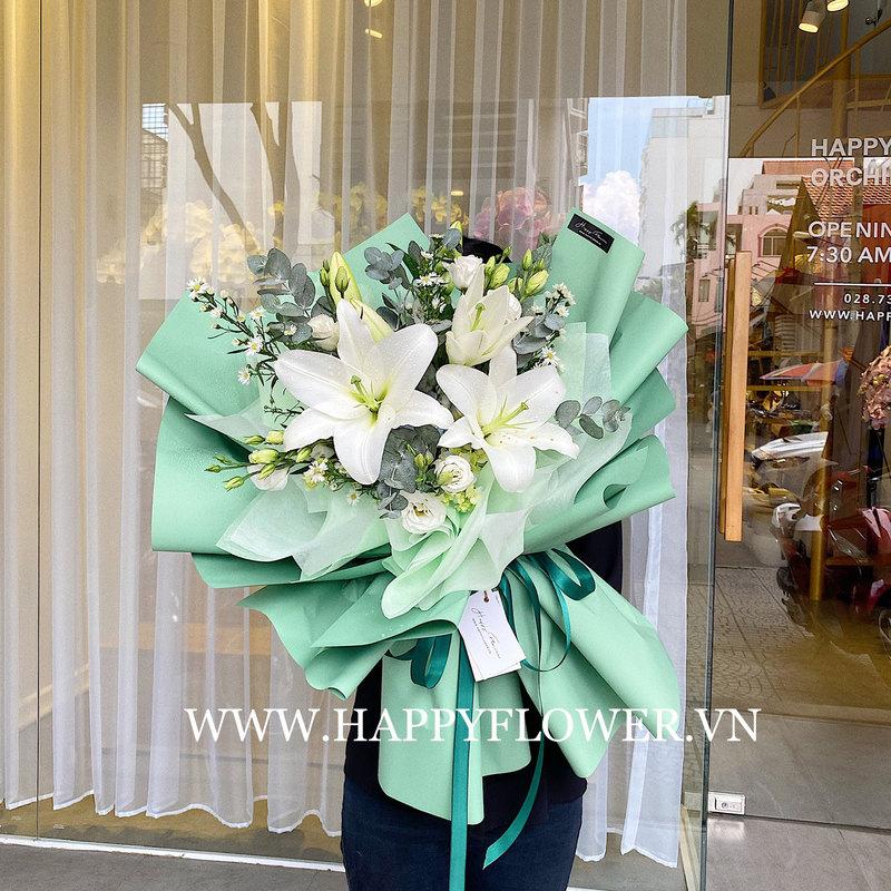 bó hoa ly trắng tinh khôi giấy gói xanh lá