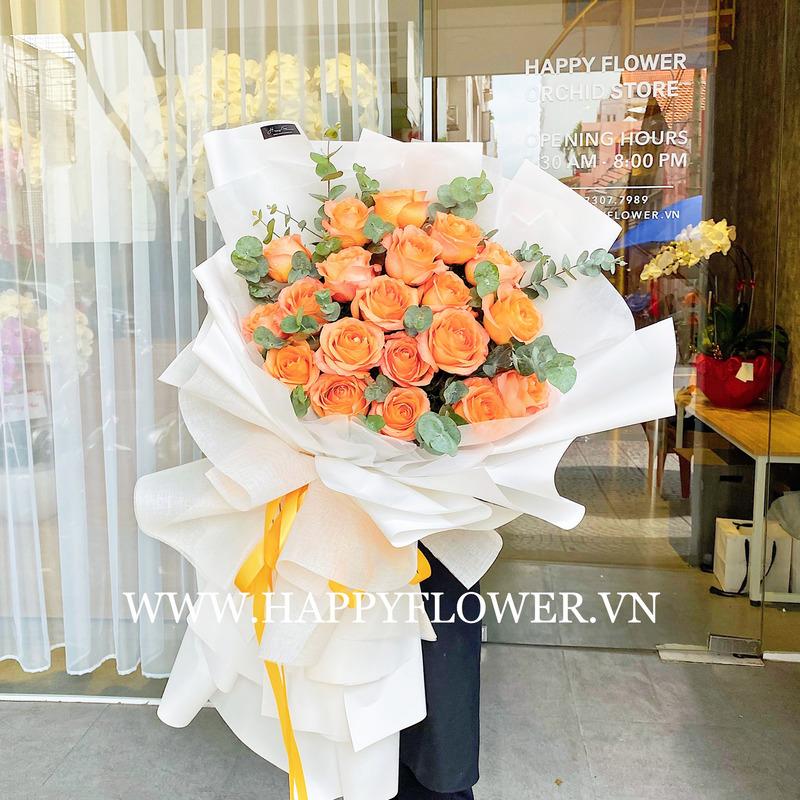 bó hoa hồng cam giấy gói trắng