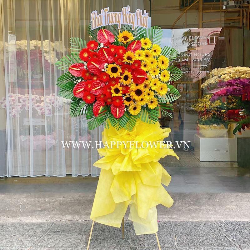 kệ hoa chúc mừng hoa hồng môn đỏ mix hướng dương vàng rực rỡ
