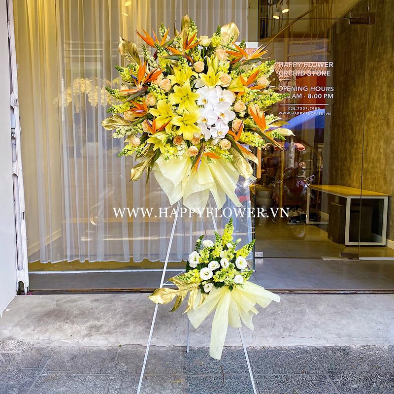 lẵng hoa ly mix lan hồ điệp chúc mừng đại hội đảng 2 tầng
