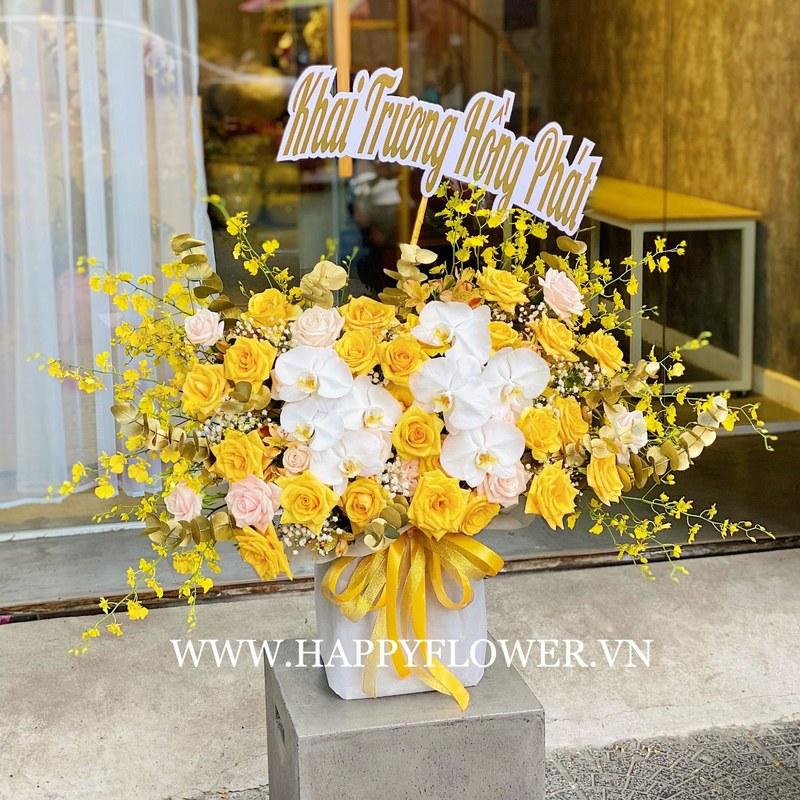 hộp hoa hồng vàng mix lan hồ điệp trắng và hoa hồng phấn