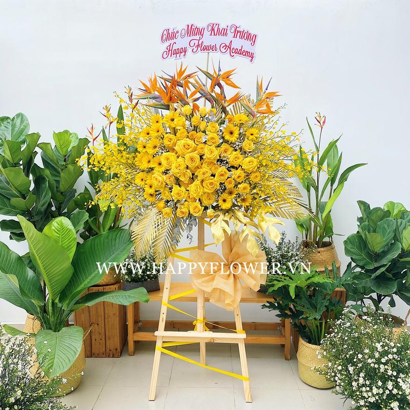 Kệ hoa gồm hoa hồng vàng, hoa thiên điểu, hoa lan vũ nữ chúc mừng thành lập công ty