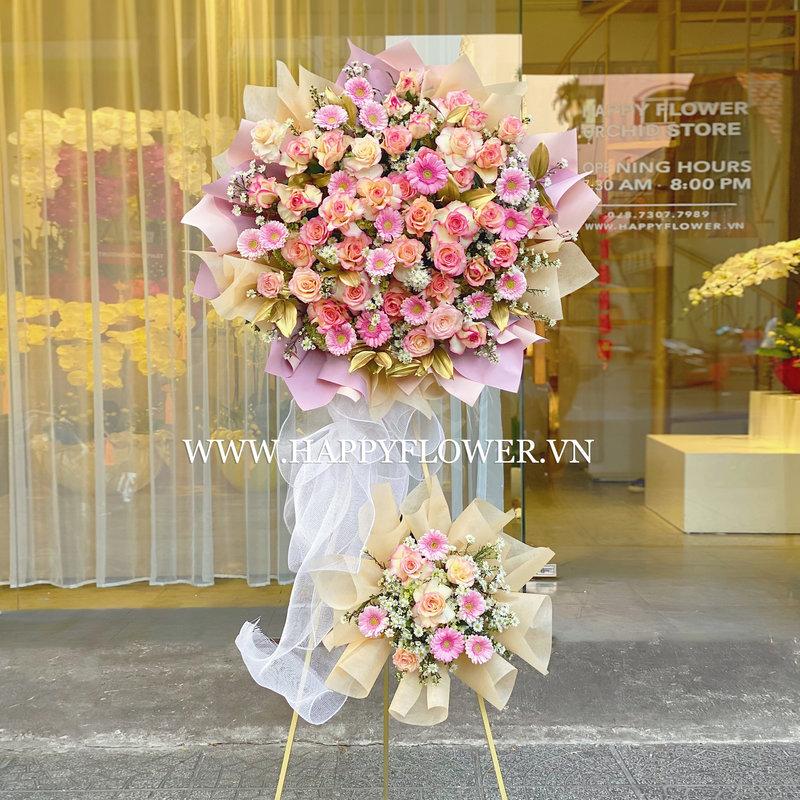 Kệ hoa 2 tầng hoa đồng tiền mix hoa hồng cam nhạt chúc mừng thành lập công ty