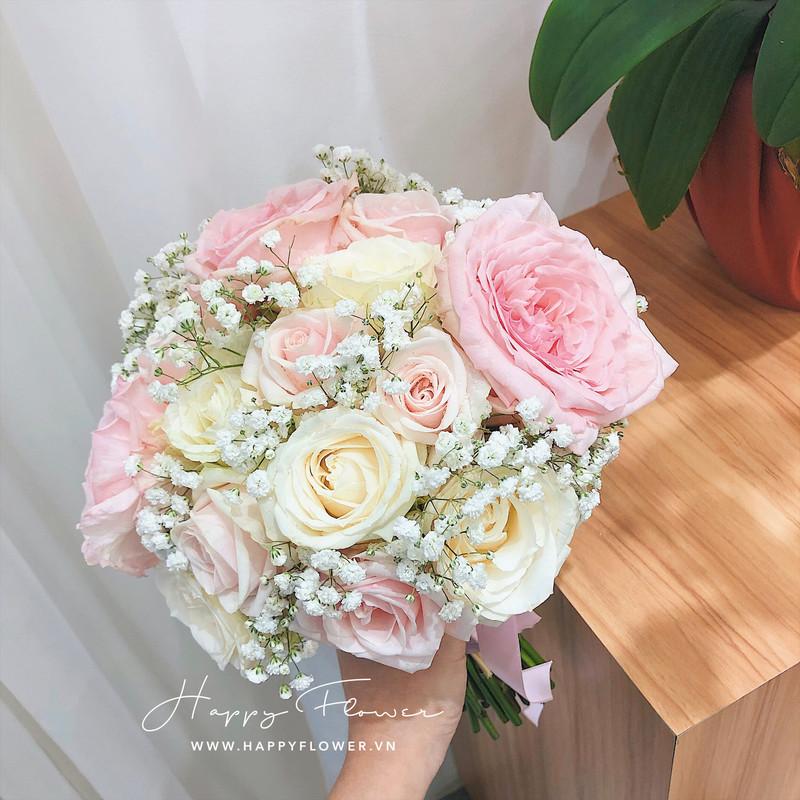 hoa cưới cầm tay hoa hồng trắng và hồng kem mix hoa baby