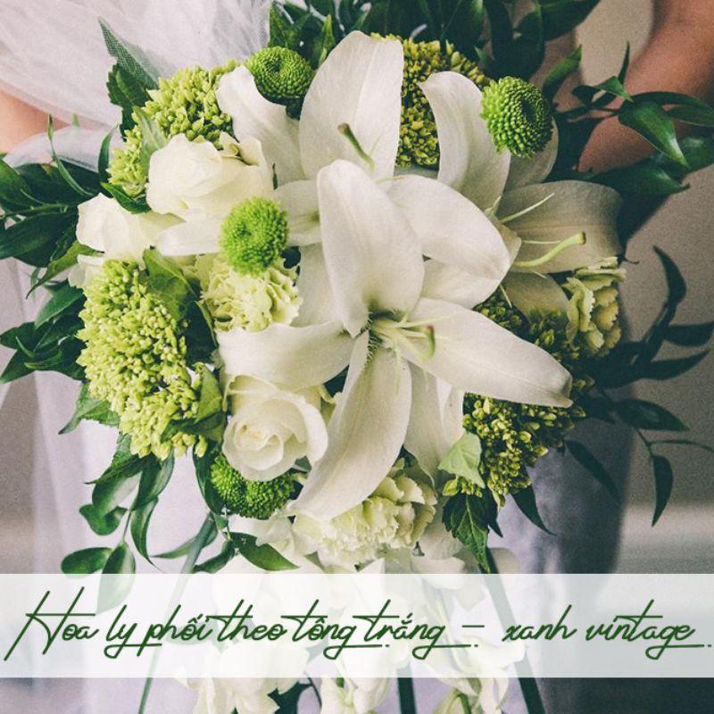 bó hoa cưới hoa ly trắng cầm tay cô dâu