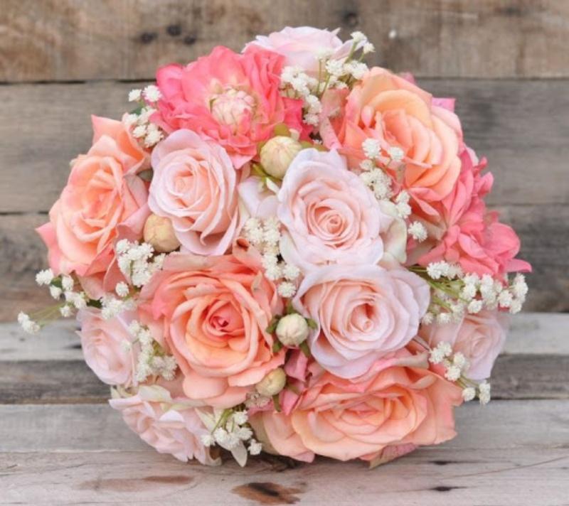 hoa cưới cầm tay làm bằng lụa tone cam
