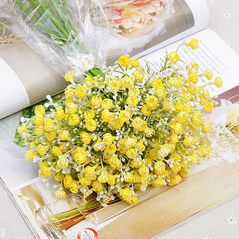Bó hoa cưới cầm tay vàng từ hoa baby vàng tinh tế