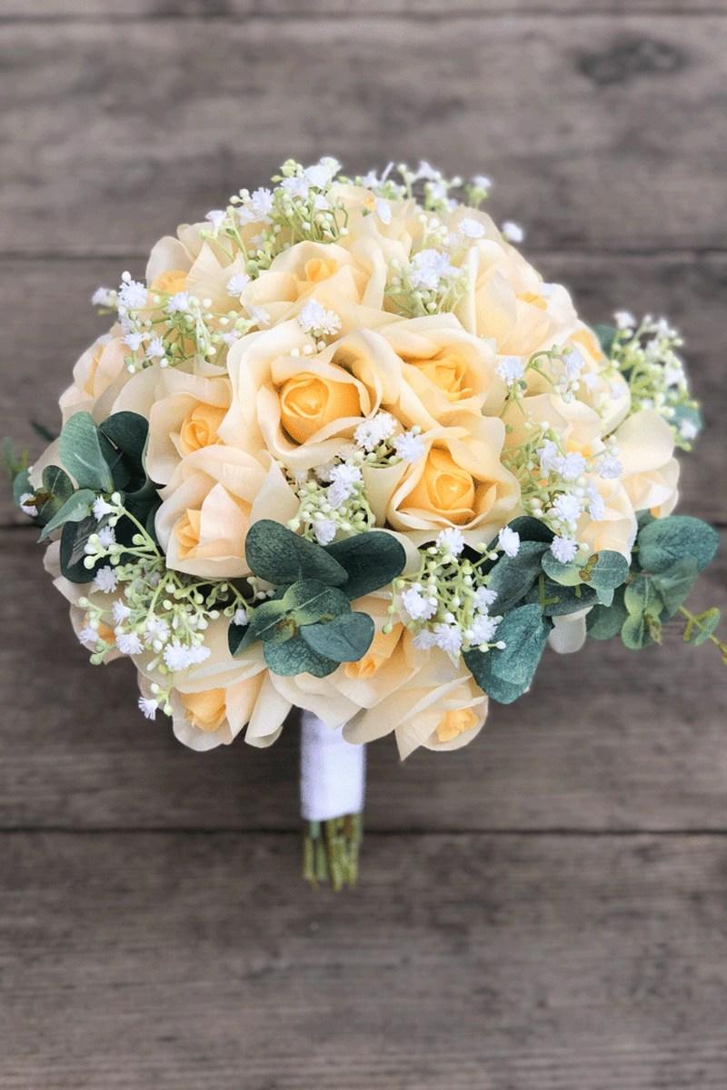 Bó hoa cưới cầm tay màu vàng cam nhẹ nhàng