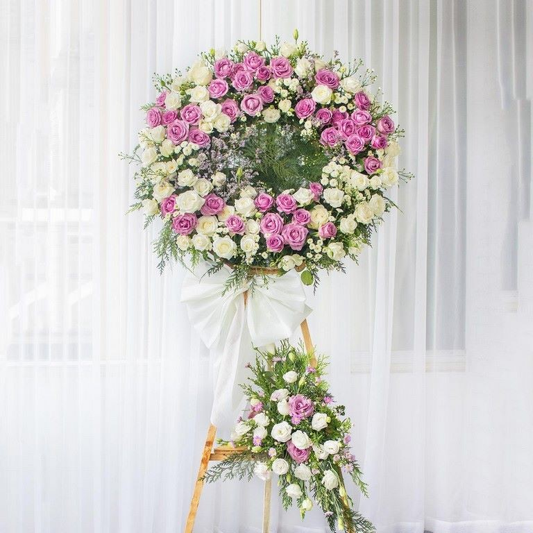 Lẵng hoa đám tang màu hồng tím