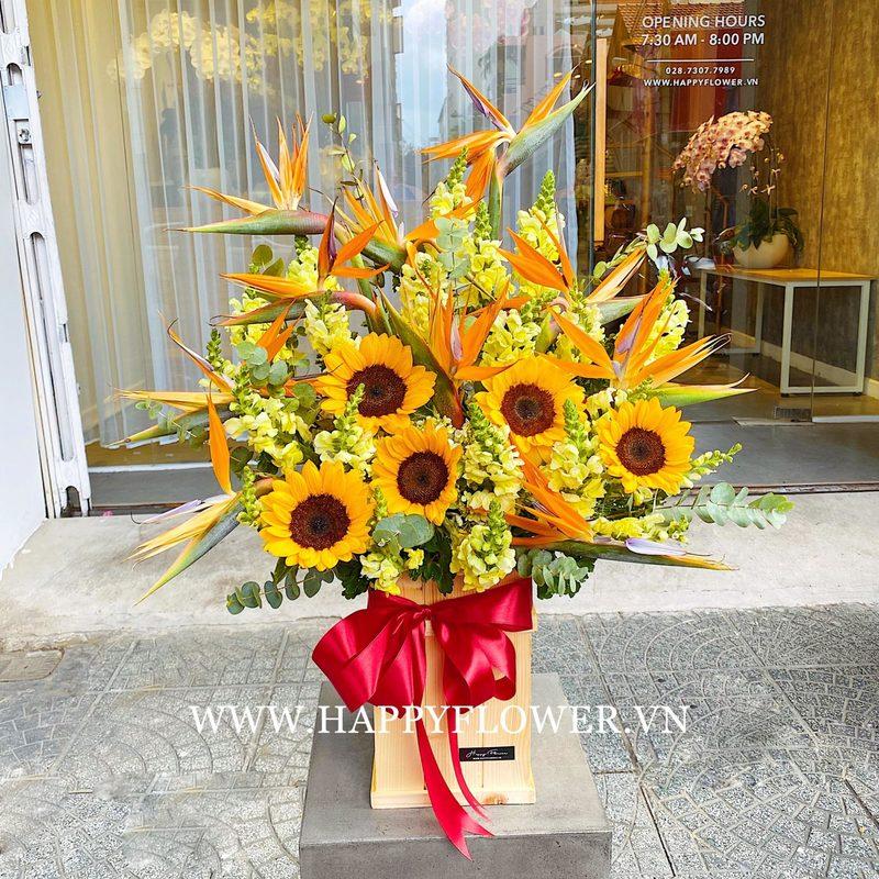 hộp hoa khai trương hướng dương vàng mix hoa thiên điểu