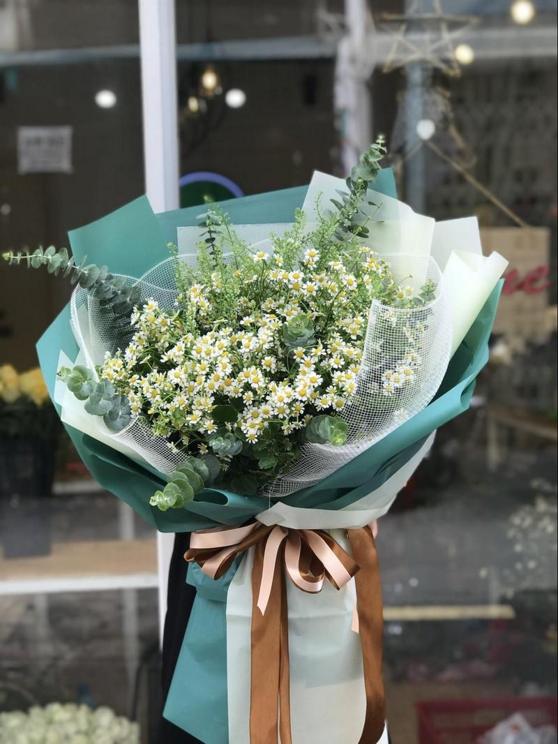 bó hoa cúc giấy gói xanh
