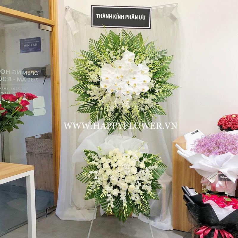lẵng hoa tang lễ 2 tầng hoa lan trắng mix hoa hồng trắng