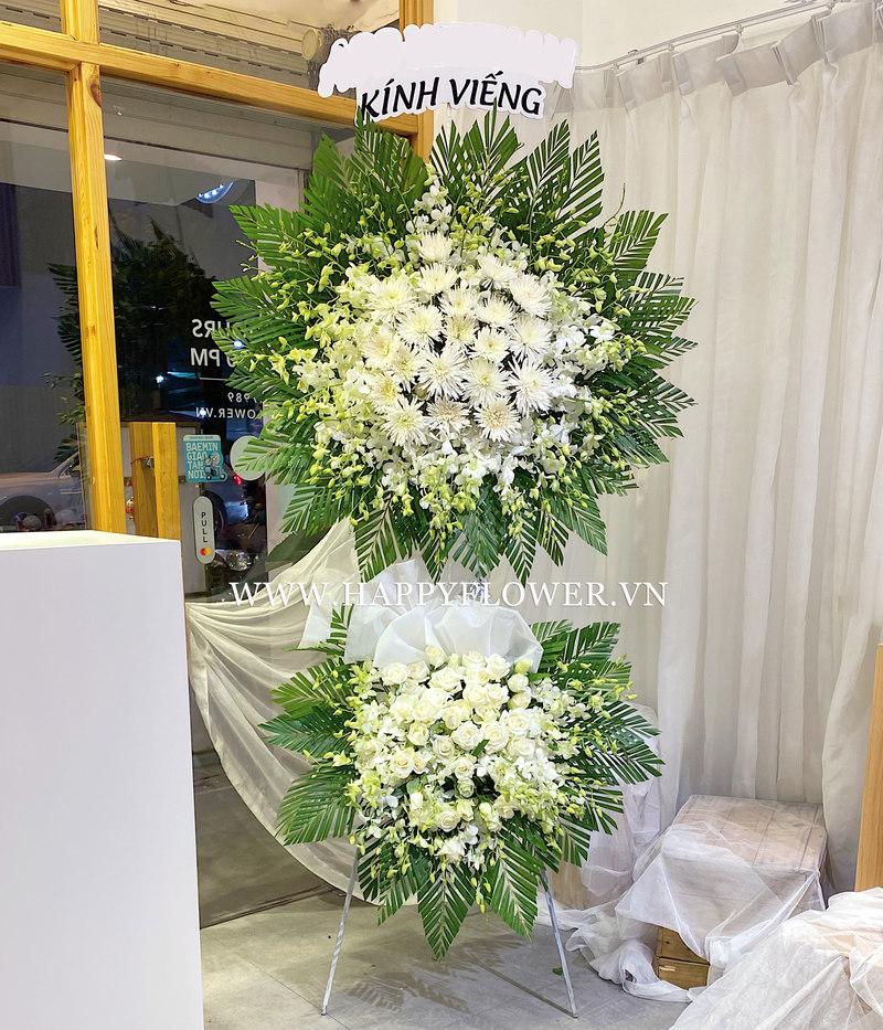 lẵng hoa tang lễ 2 tầng hoa cúc trắng mix hoa hồng trắng