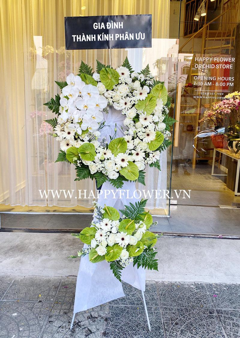 lẵng hoa tang lễ 2 tầng hoa đồng tiền trắng mix lan hồ điệp trắng