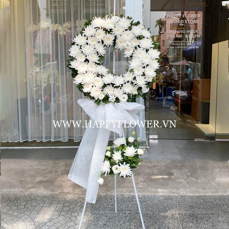 vòng hoa đám tang hình tròn tông trắng