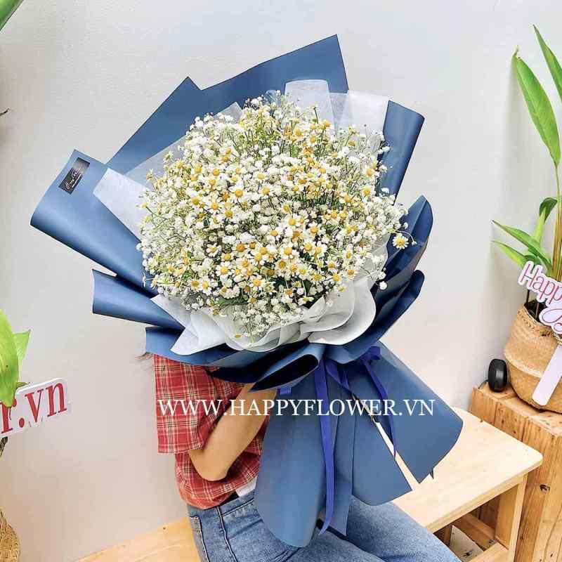 bó hoa cúc họa mi gói giấy xanh